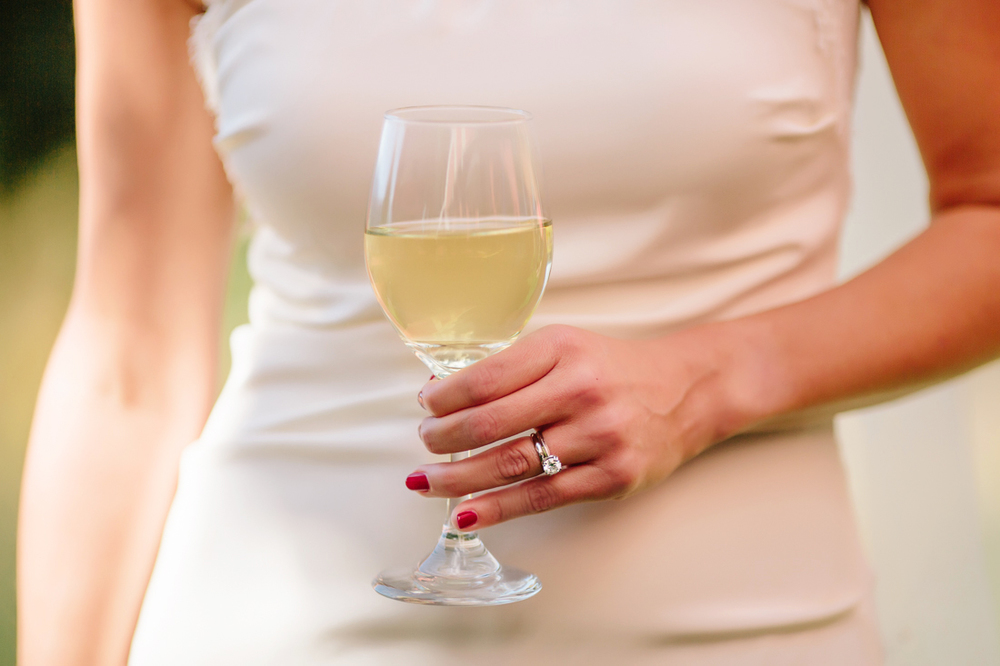 Aspen Wedding Photography | Bride with a Glass of White Wine and Wedding Ring | Cat Mayer Studio | www.catmayerstudio.com