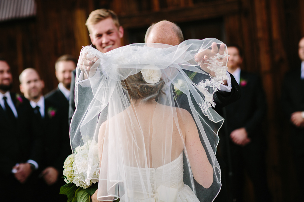 Father Places Veil While Groom Smiles | Photography by Cat Mayer Studio | www.catmayerstudio.com