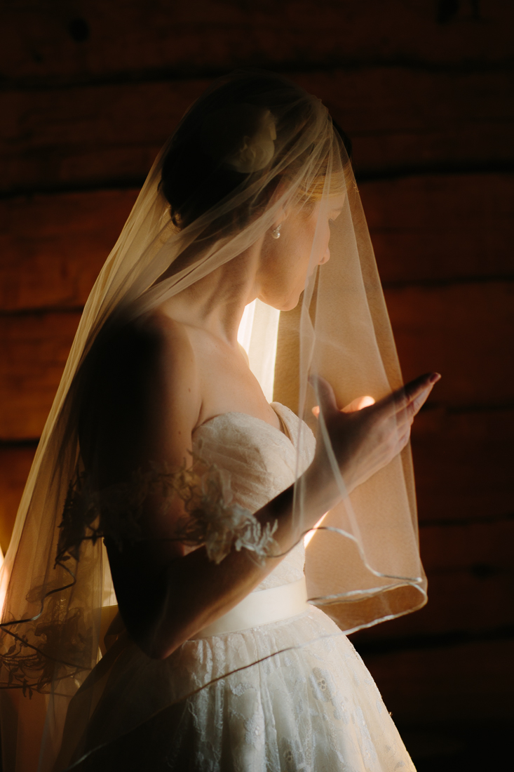Telluride Wedding Photography | Bride with Long Veil and Pearl Earrings | Cat Mayer Studio | www.catmayerstudio.com