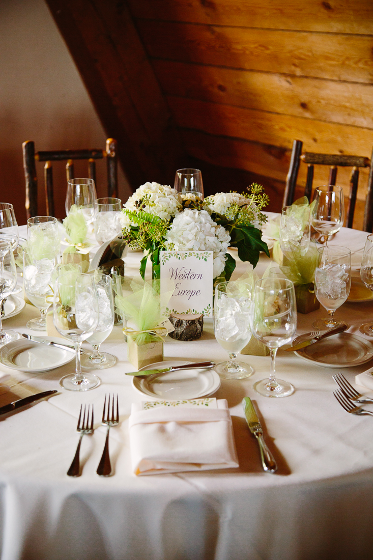 Green and White Center Pieces on Tables for Garden Inspired Wedding | Cat Mayer Studio | www.catmayerstudio.com