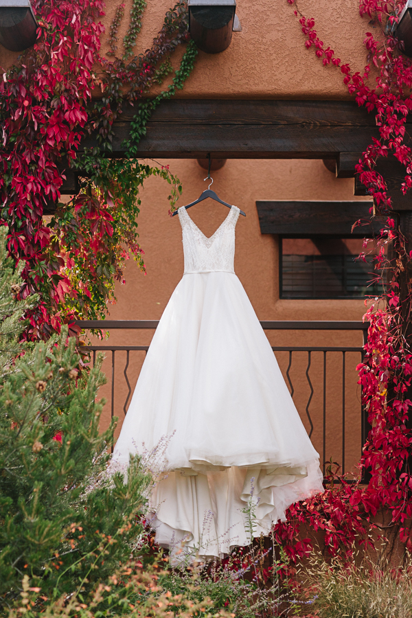 Long White Halter Wedding Dress Hanging Outdoor | Cat Mayer Photography | www.catmayerstudio.com
