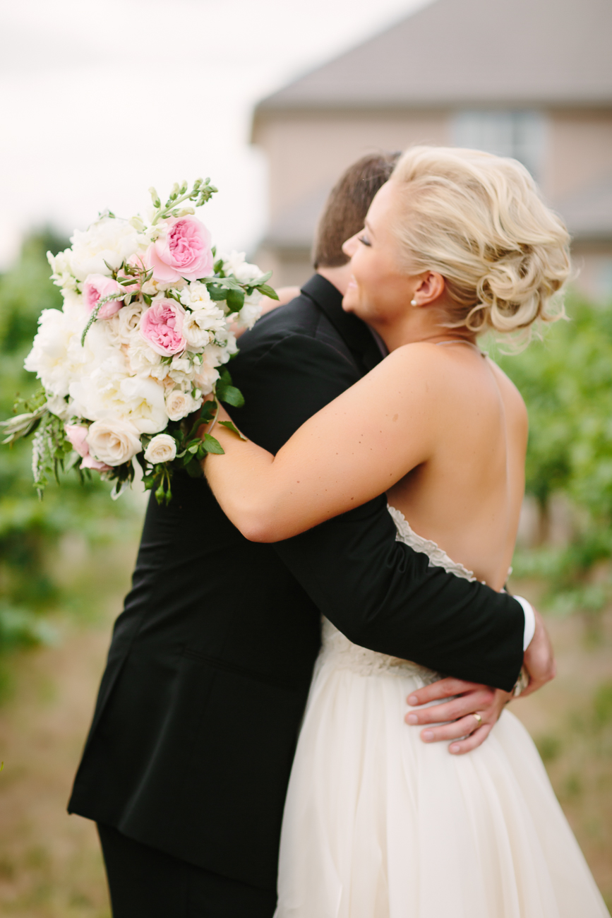 Wedding Couple Hug in Vinyard | Cay Mayer Studio | www.catmayerstudio.com