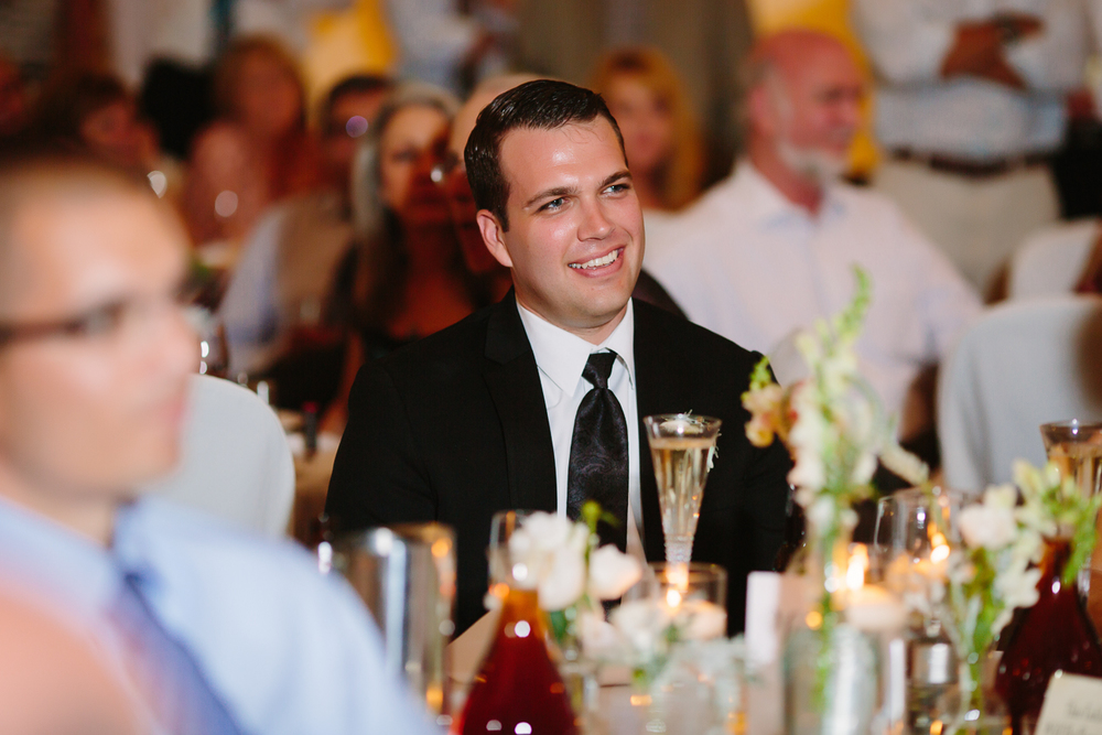 Groom Smiles During Toast | Cay Mayer Photography | www.catmayerstudio.com