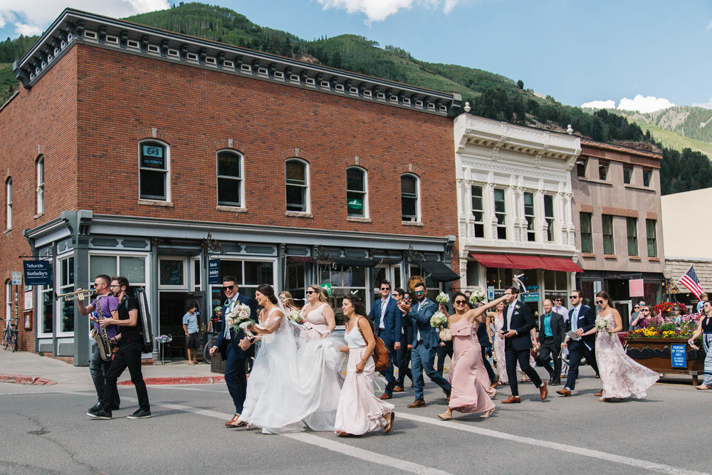 Horn players leading the wedding parade down Main Street/Colorado Avenue
