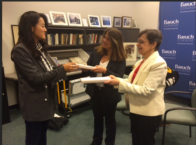 Professors Sandra Roff and Shelley Spector are presented with gifts of handmade ebony couple-ring chopsticks.