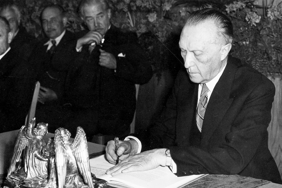 "Konrad Adenauer, (West-)Germany's First Post-War Chancellor, signing the ""Grundgesetz"" (Basic Law)."