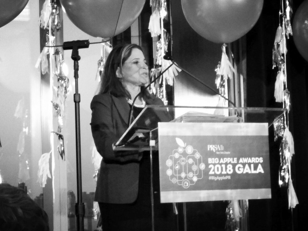 Shelley Spector giving a speech on stage at Big Apple Awards Ceremony   Photo by Roger Bolton