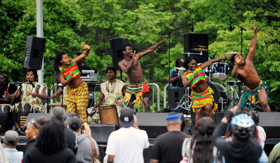 Modern Day Juneteenth Celebration: members of the Tsoloi Ensemble perform a traditional African dance at the Juneteenth celebration in Washington  Photo by Times Union.