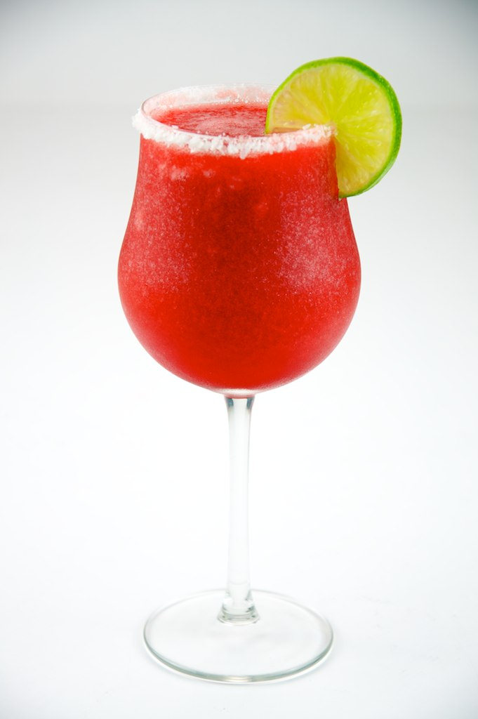 The Daquiri - A popular choice in the summertime, the daiquiri is refreshing, social, fun, and cool. It's made simply with lime juice, sugar, and rum, but can also be filled with frozen fruits like banana or strawberry.