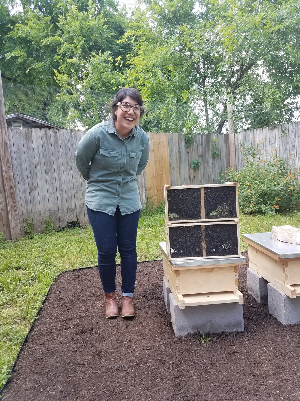 Look at Jackie and how excited she is about her two new package of bees!