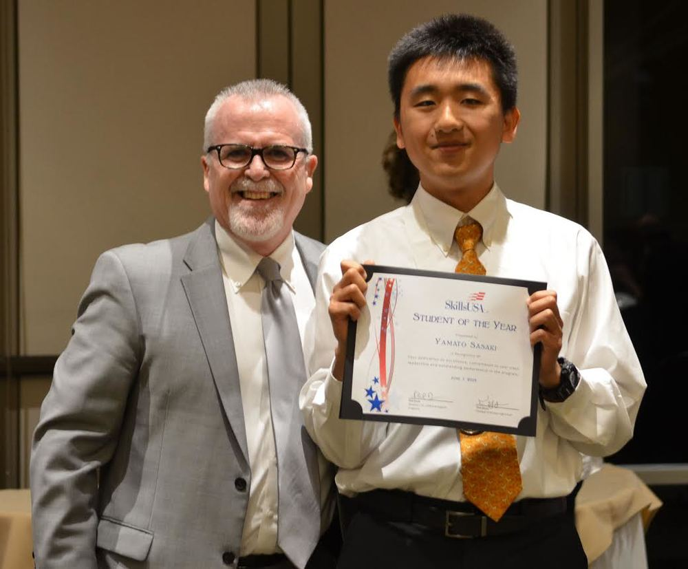 CTE and STEM director Phil Davis with Downey High School's SkillsUSA Student of the Year award winner Yamato Sasaki.