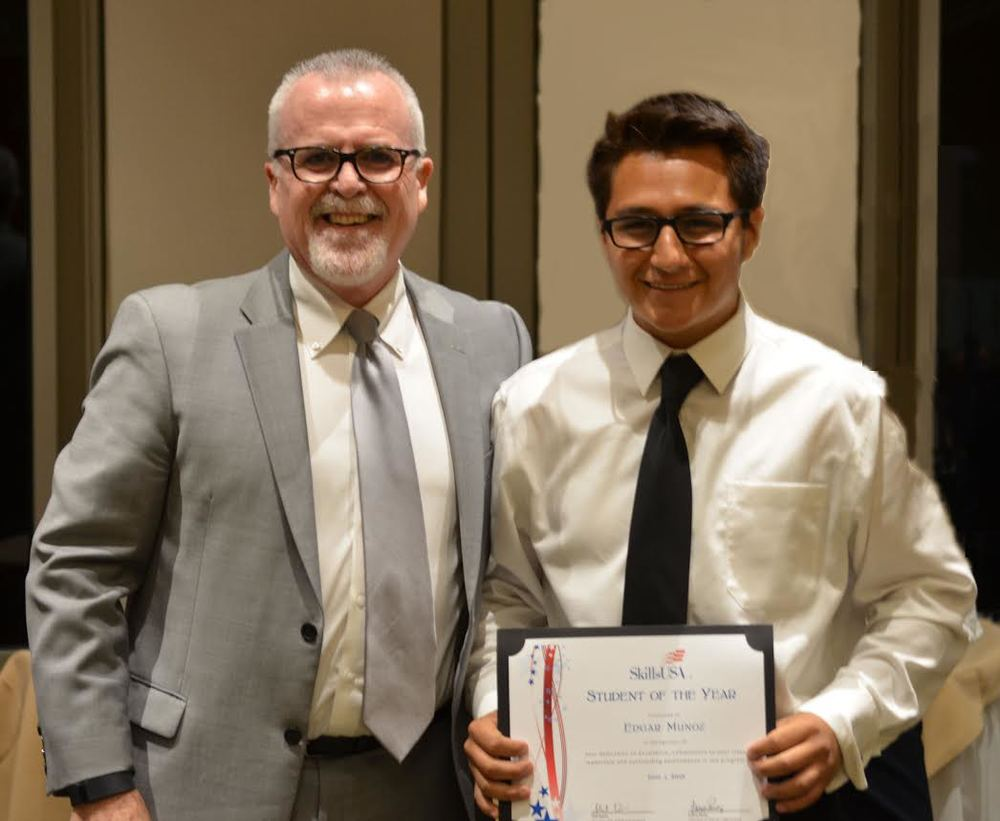 CTE and STEM director Phil Davis with Warren High School's SkillsUSA Student of the Year award winner Edgar Munoz.