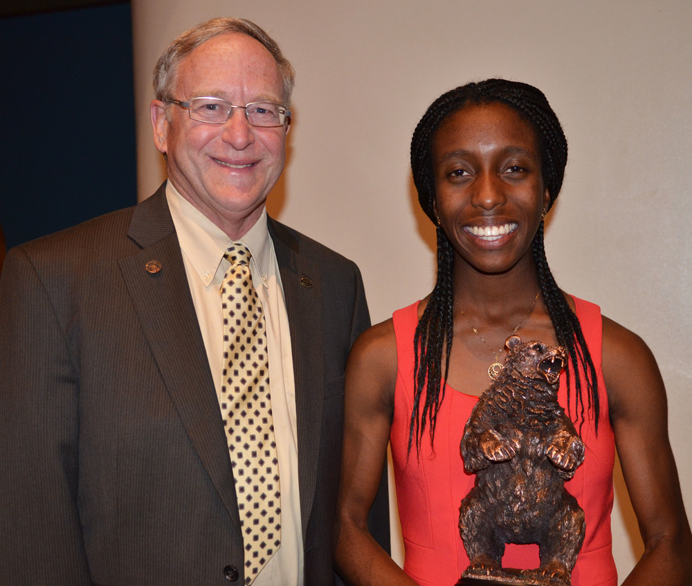 Warren High's Grand Golden Bear, Nwamaka Amobi,  will be attending Massachusetts Institute of Technology (MIT) in the fall. She is pictured with DUSD board of education president Tod Corrin.