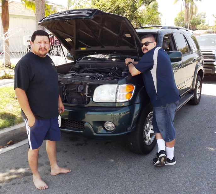 Miguel and Jaime Arvizu spent Father's Day working on a truck.