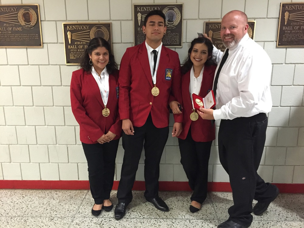 The team of Giselle Ramos, Anthony Laverde and Sonia Gomez received gold medals in the category of Career Pathway Showcase- Health Science. They are pictured with their advisor, Chris Zessau.