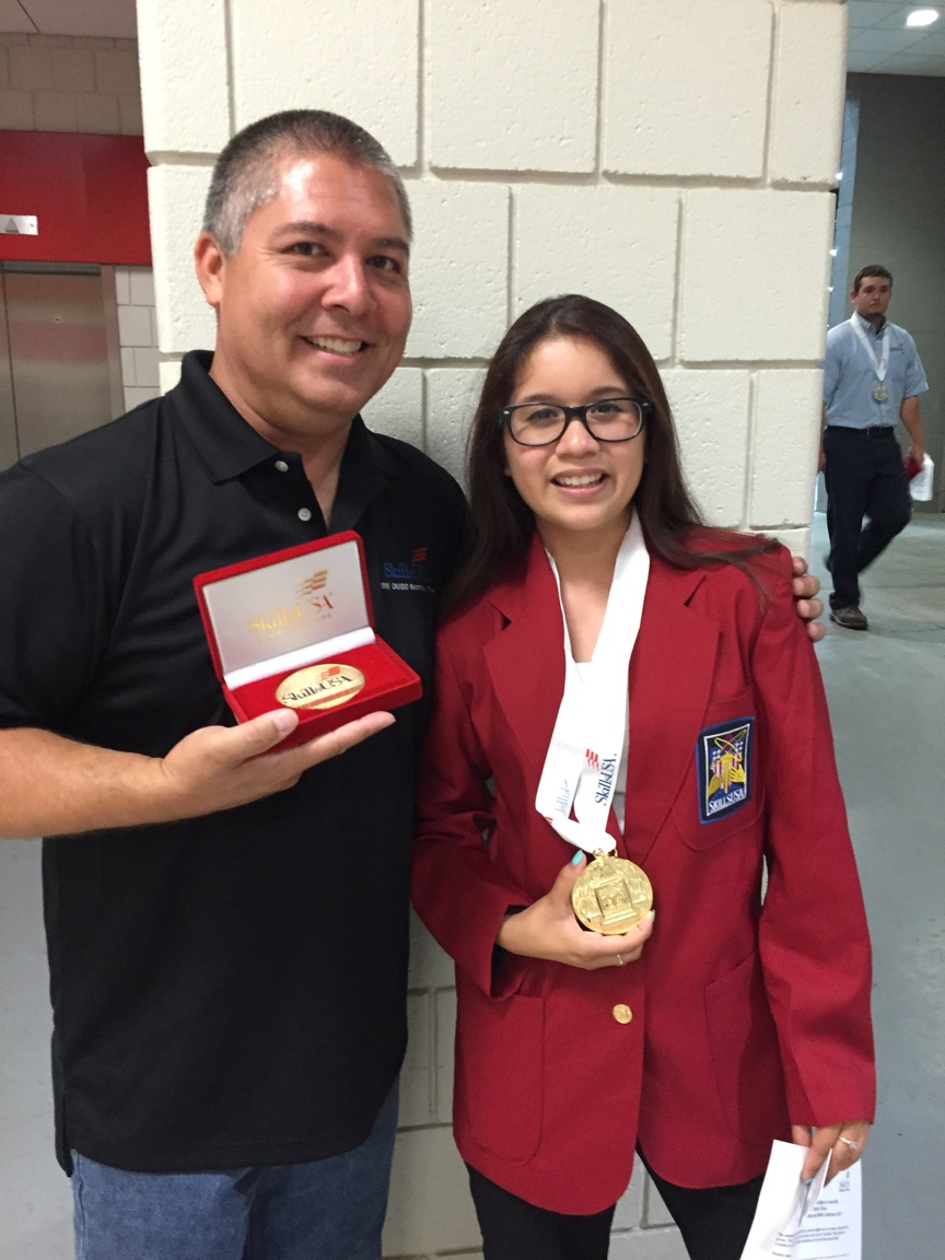 Hannah Rodriguez poses with her advisor, Glenn Yamasaki, after receiving a gold medal in the category of Principles of Engineering Technology at last week's National SkillsUSA Competiton.  She will be competing internationally in Brazil, along with three other Downey Unified students, in August.