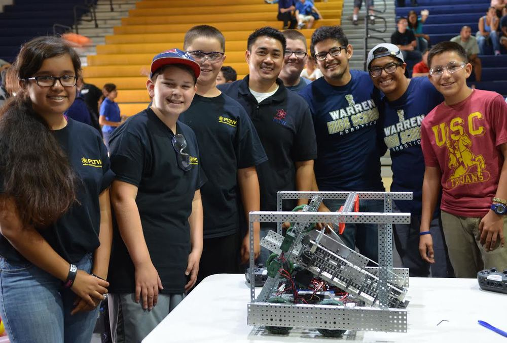 Robotics  teams from both Stauffer Middle School and Warren High School collaborated to beat the competition at Saturday's VEX Robotics Competition held at Warren High School.