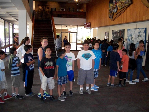 Fifth-graders line up as they prepare to enter the Downey Theatre for a free Downey Symphony concert on April 16.