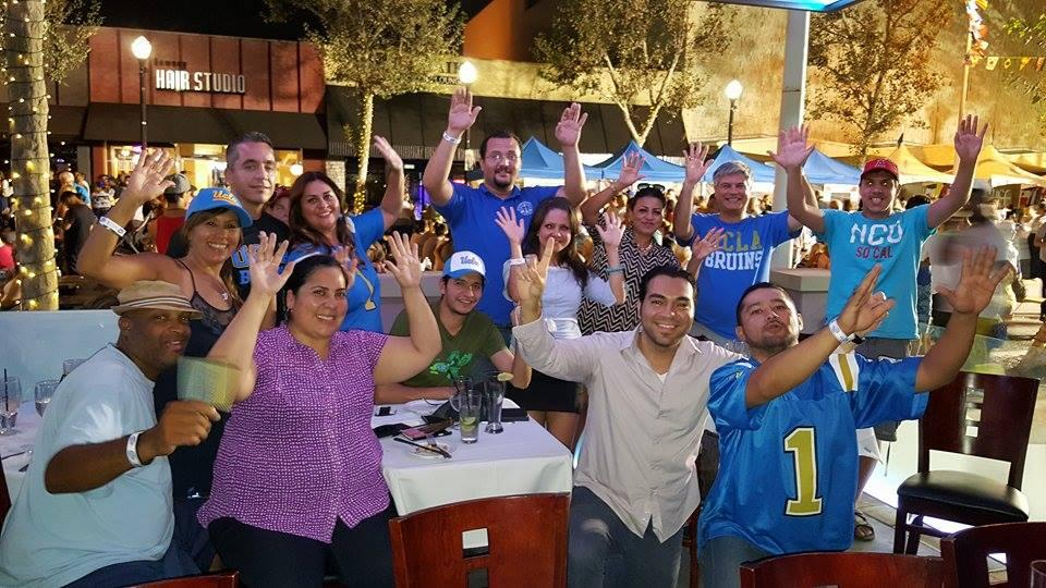 UCLA alumni, fans, and supporters performed the university's popular 8-Clap cheer at the Downey International Food Festival last Saturday.