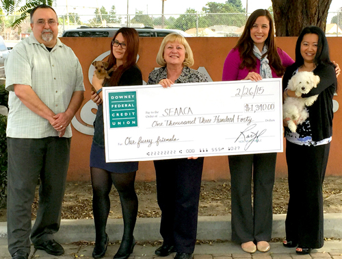 Downey Federal Credit Union employees are pictured making a donation to SEAACA. The credit union recently donated nearly $6,000 to local charities.