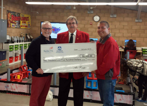 Phil Davis, director of support programs, CTE and STEM for Downey Unified (left) and Glen Yamasake, a CTE teacher at Downey High (right), accept a $2,500 grant from Clay Mitchell, director of the California Department of Education SkillsUSA.
