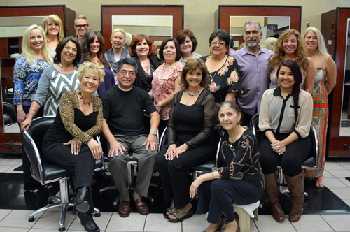 Salon owner Miguel Bardales, seated second from left, says that Johnny & Co. will be closing its doors after nearly four decades.