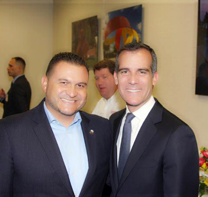 Downey Mayor Luis Marquez, left, and Los Angeles Mayor Eric Garcetti.