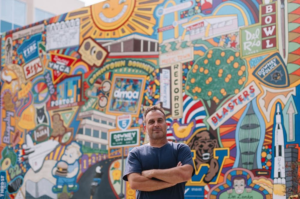 Don Lamkin in front of his mural on Downey Avenue, 'Downey Doodle-icious'. Lamkin will be exhibiting his first solo exhibition Oct. 23 at Stay Gallery from 7-11 p.m. This exhibition will also be celebrating Stay Gallery's three-year anniversary. Event is free and open to general public.