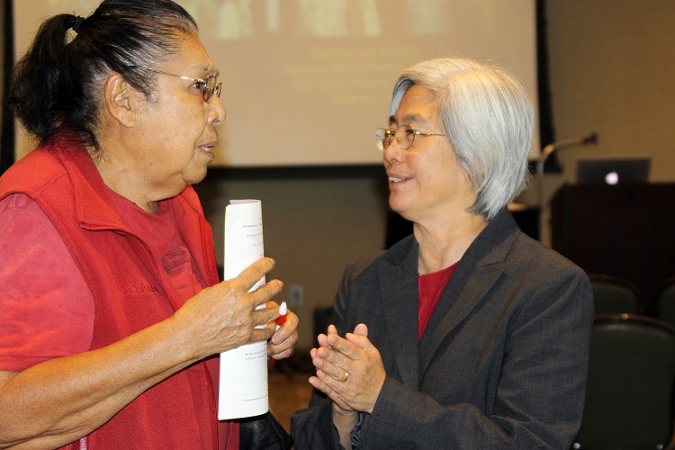 Dr. Helena Chui speaks to a stroke prevention seminar attendee last year. Photos by Greg Waskul