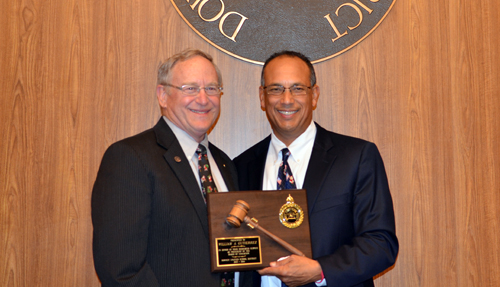 Tod Corrin, left, was named president of the Downey school board Tuesday, replacing Willie Gutierrez.