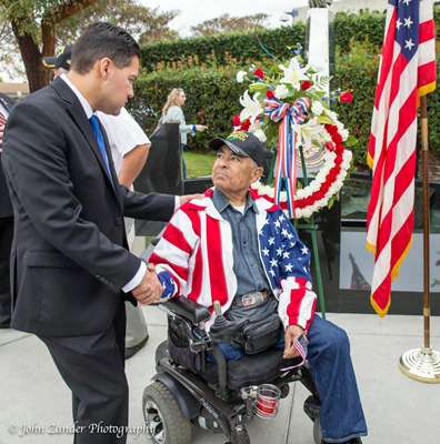 Mayor Fernando Vasquez thanks a veteran for his military service at a Veterans Day ceremony last week.
