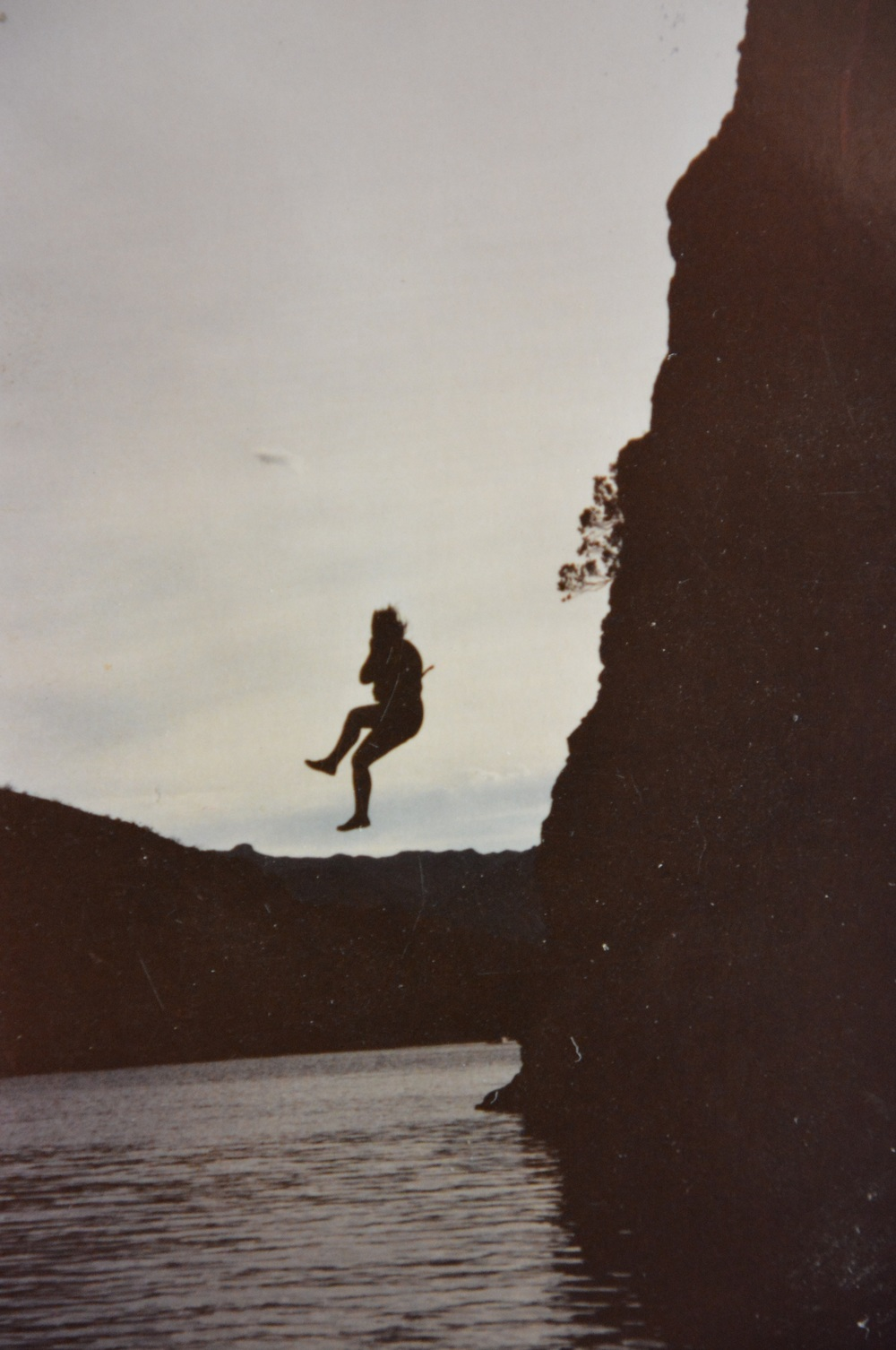 The author's sister Jan as she jumps into a lake by the Colorado River.