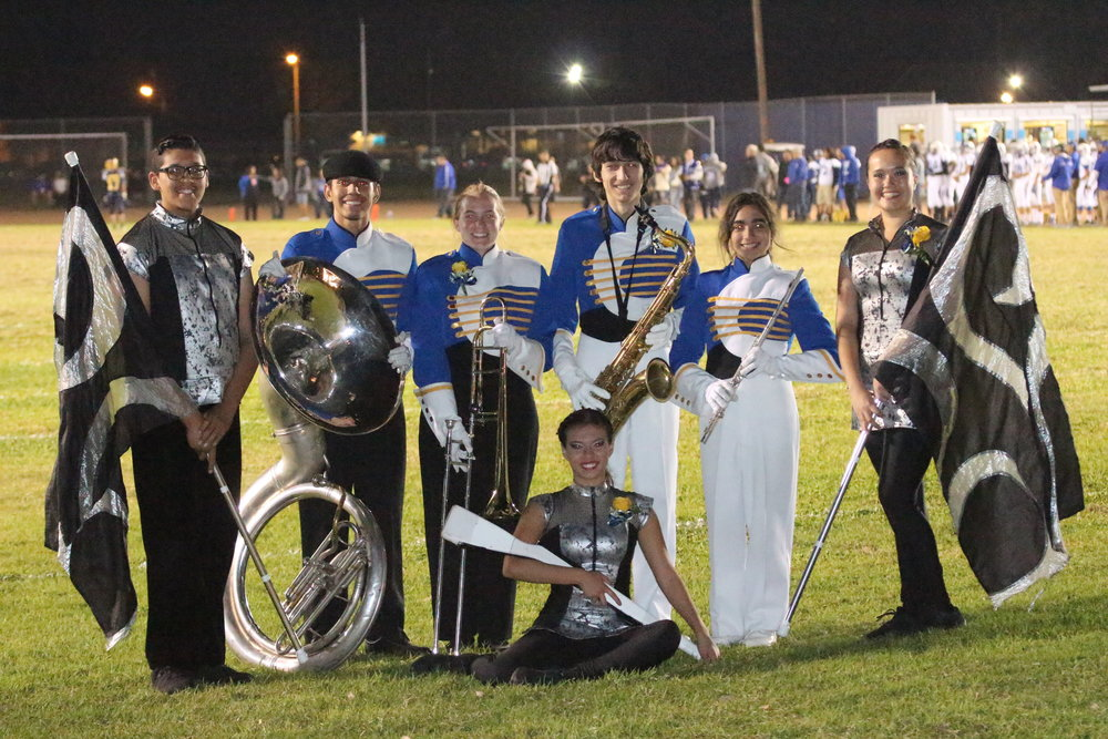 Seven California High School students won coveted spots in the Pasadena City College Tournament of Roses Honor Band, including, from left, Erick Gonzalez (banner); Gus Sausedo (tuba); Haley Nelson (trombone); Bryanda Vega (tall flag – sitting on floor); Colin Ward (sax); Olivia Huizar (flute); and Alicia Huerta (banner).