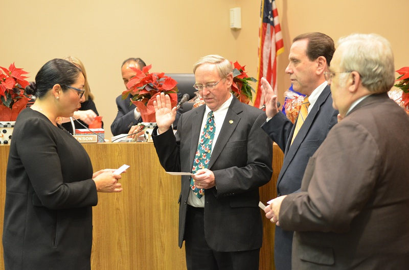 Assemblymember Cristina Garcia administers the Oath of Office to reelected Board members Tod Corrin, D. Mark Morris and Donald LaPlante (from left to right) at last Tuesday's Downey Unified Board of Educating meeting.