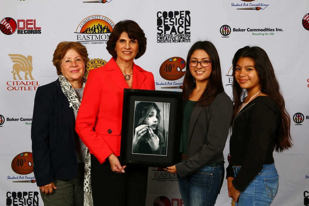 Congresswoman Roybal-Allard (second from left) with 2015 art competition winner Sabrina Claros (second from right) and Sabrina's family members.