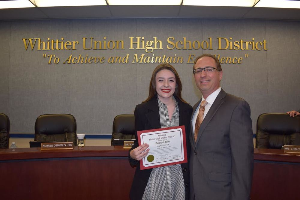 Joined by California High School Principal Bill Schloss, senior Sophia Aldecoa on Jan. 12 received an Award of Merit from the Whittier Union School District Board of Trustees for overcoming personal obstacles to become a student leader and academic achiever on campus.