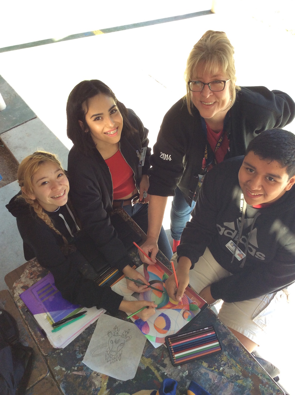 California High School art teacher Julie Tonkovich works on a project with students Devinee Parra, left, Natalie Mancillas and Christian Gutierrez. Tonkovich is one of only 10 public school teachers appointed to serve on the Instructional Quality Commission, an advisory body to the State Board of Education.