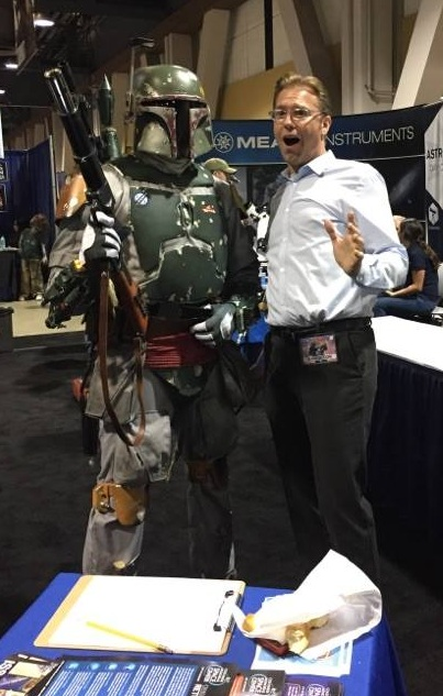 Space center executive director Ben Dickow (right) has fun at the Long Beach Comic Expo.