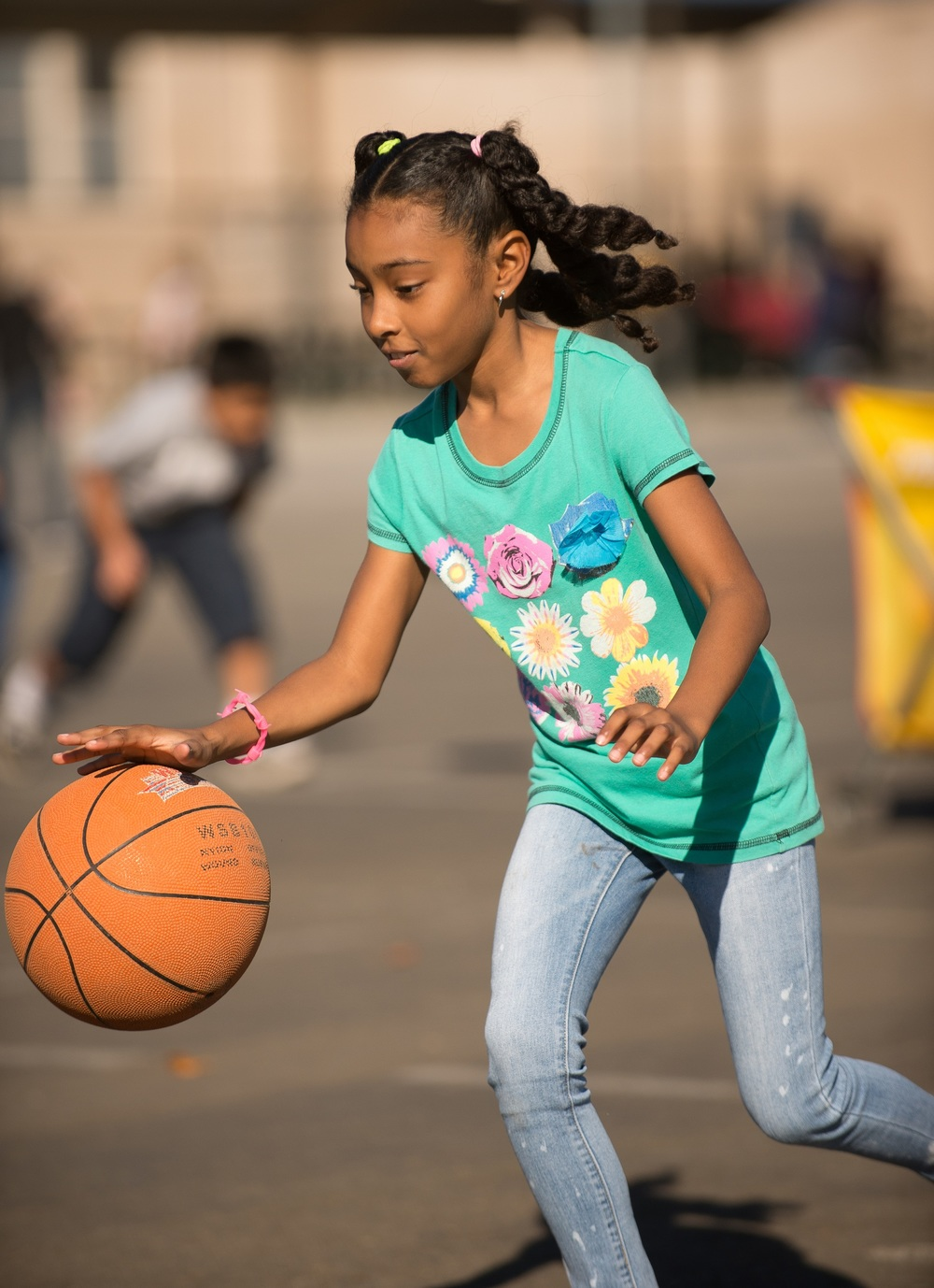 Woodruff Elementary fourth-graders work on their basketball handling skills during a recent dribbling exercise.