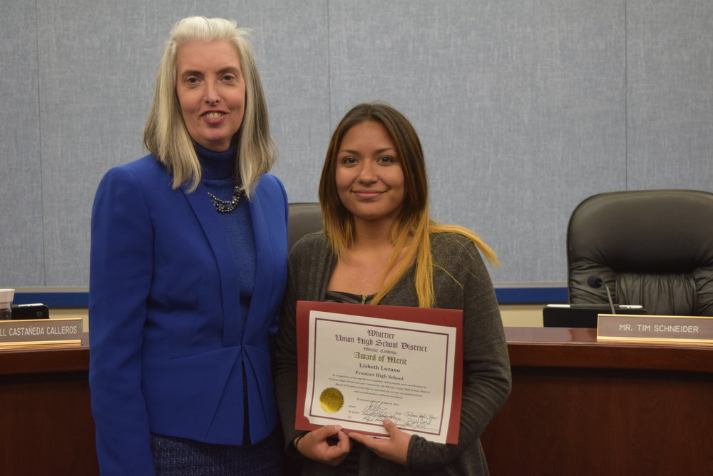 Lisbeth Lozano enrolled at Frontier High School as a second-semester sophomore with zero credits, having lived in Guatemala for the previous three years. She is now No. 1 in her class and on track to graduate early, earning her an Award of Merit from the Whittier Union High School District Board of Trustees on March 8. She is pictured with Principal Margie Moriarty.