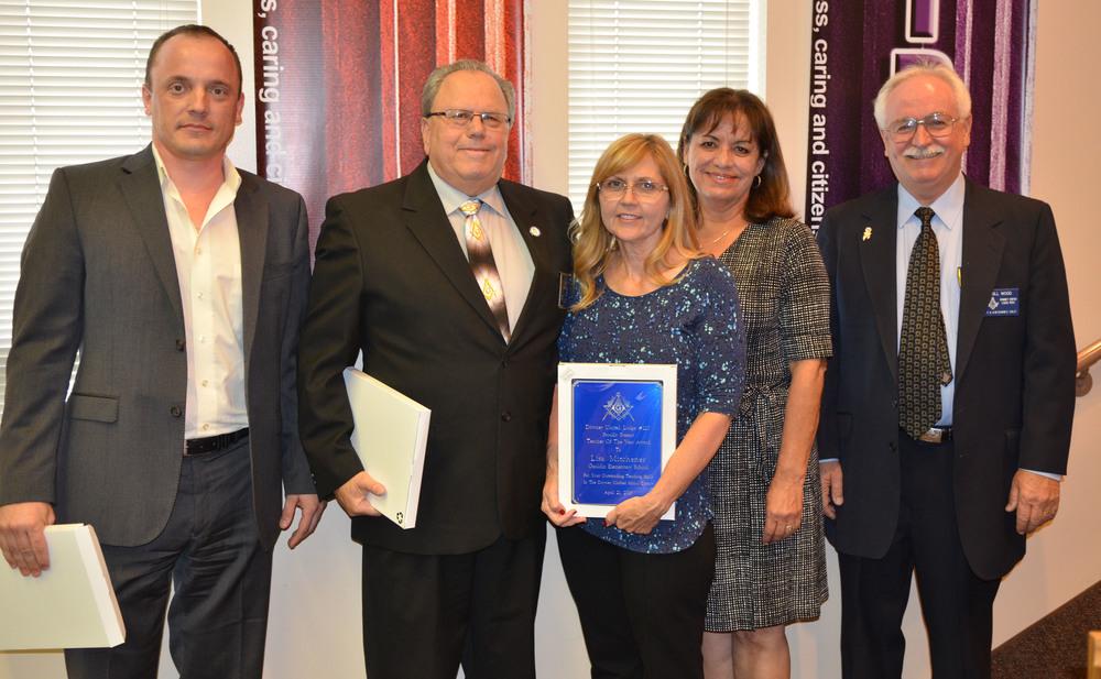 From left: Aleksey Duplinsky, Downey Masonic Lodge 220's senior warden; Gary Phillips, Downey Masonic Lodge 220's master; Lisa Mitchener, 2016 Masonic Teacher of the Year; Dolores Goble, Gauldin Elementary principal and Bill Wood, Downey Masonic Lodge 220's junior warden.