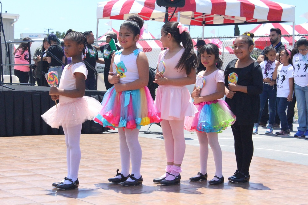 "Lugo and Rosa Parks elementary schools' Princess Feet Ballet students get ready for their dance to ""Lollipop"" during Lynwood Unified's third annual festival of the arts, themed The Woods, on May 21."