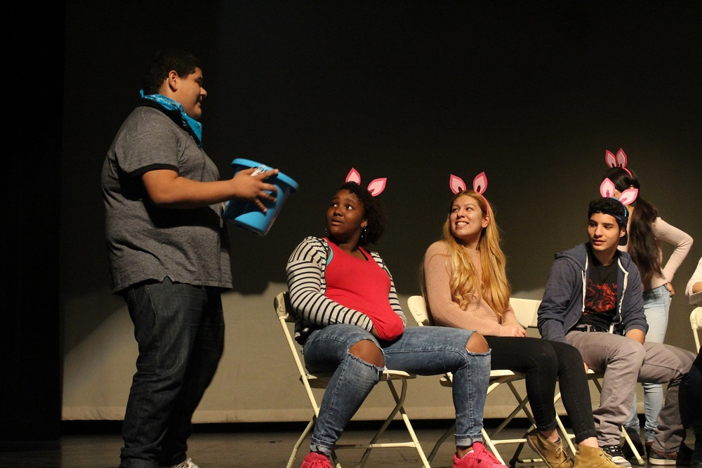 "Lynwood High School students perform a ""12 Angry Pigs"" skit during Lynwood Unified's third annual festival of the arts, themed The Woods, on May 21."