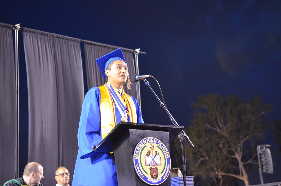 Warren High graduating senior Omar Gatica-Analco addresses his fellow students at commencement ceremonies last week. Omar graduated with a 5.0 GPA, the highest grade point average in the school's history.