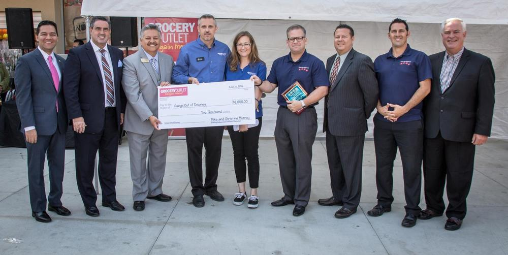 Grocery Outlet presents a $2,000 donation to Gangs Out of Downey. Photo by John Zander