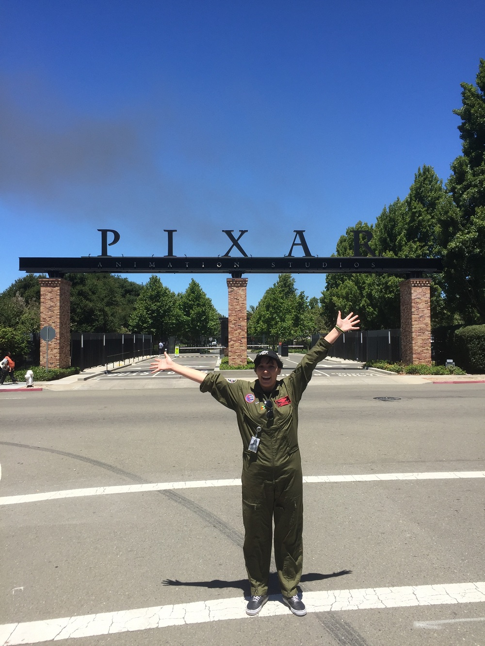 "Briana Ornelas, former WHS student, at Pixar Animation Studios entrance wearing an original jumpsuit from the movie ""Top Gun"", which is the theme for this year's summer internship program."