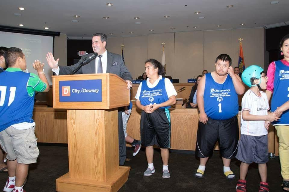 Mayor Alex Saab congratulates members of Downey's Special Olympics basketball team.