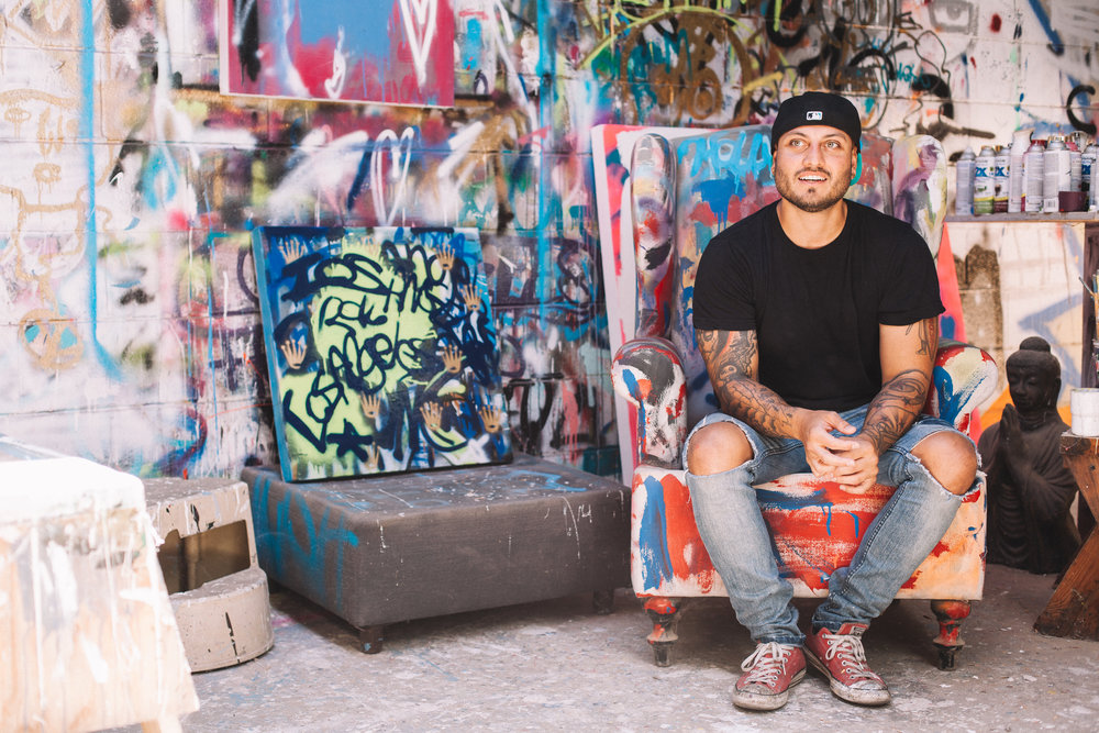 "Joshua Galindo inside his studio. Stay Downey will host an opening reception Sept. 9 for Galindo's newest exhibit, titled ""ESQUSIT."" Photo by Matthew Ward"