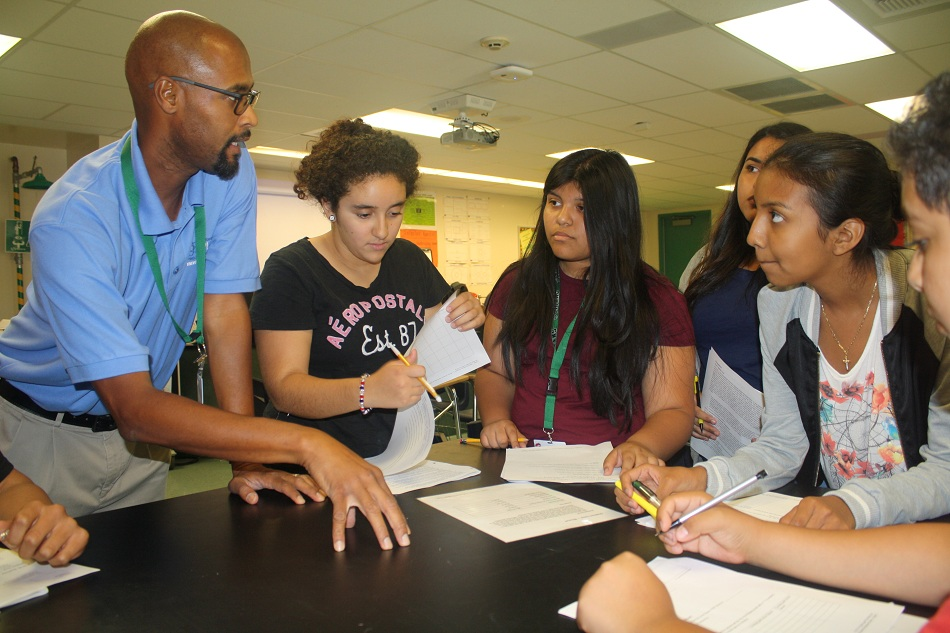 Pioneer High School biology teacher Kenneth Guidry teaches a group of students how to evaluate evidence as part of a crime scene investigation during a class he teachers on the principles of biomedical science, one of a host of new science, technology, engineering and math (STEM) courses Whittier Union launched this school year.