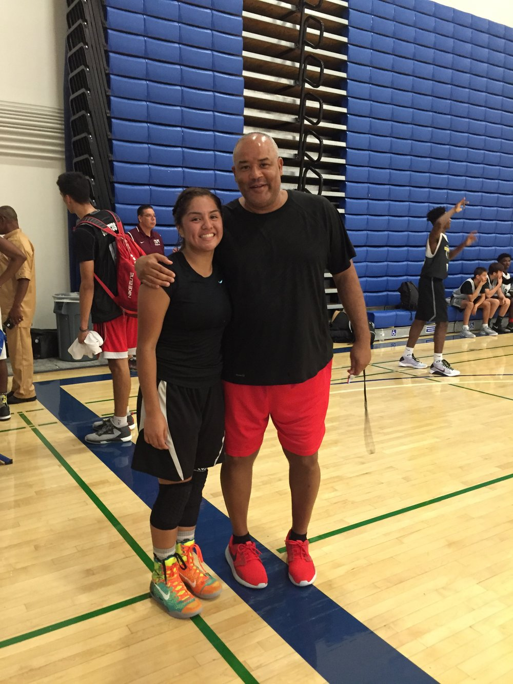 Surie Camacho with former college basketball coach and current ESPN anaylyst Reggie Rankin.
